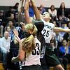 BRYAN EATON/Staff Photo. Pentucket's Carolyn Modlish tries for the rebound.