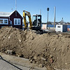 BRYAN EATON/Staff Photo. Work has begun on the new Newburyport Harbormasters headquarters to replace the present structure at left.