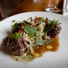 BRYAN EATON/Staff Photo. Beef polpette with charred cabbage, and pickled mushroom salad from Ceia Kitchen and Bar.