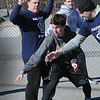 BRYAN EATON/Staff Photo. Salisbury police Lt. Anthony King, left, backs off to avoid a foul during a basketball pitting the department with local teens.