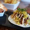 BRYAN EATON/Staff Photo. Metzy's Taqueria's short rib taco with fresh mango Habenero salsa.