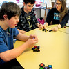 Newburyport: Newburyport High School senior Alex Edwards, right, helps Jared Bedard, left, and Eoin Robertson start a game of Qwirkle in the Best Buddies program at the high school. Bryan Eaton/Staff Photo