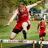 Newburyport: Amesbury's Patrick Halloran takes first in the 400 yard hurdles. Bryan Eaton/Staff Photo