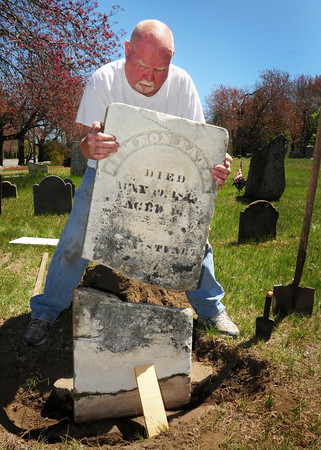 Salisbury: Paul Turner checks the fit the broken gravestone of Simeon Eaton at the Salisbury Colonial Burying Ground he's repairing. The new chair of the Salisbury Historical Commission has been repairing several other stones in disrepair in the town-owned cemetery founded in 1639. Bryan Eaton/Staff Photo