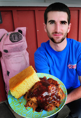Rowley: Lee Pierro of All American Barbecue in Rowley shows off their pulled pork and corn bread which will be one of the offerings at Taste of Plum Island. Bryan Eaton/Staff Photo