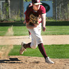 Newburyport: Newburyport pitcher Connor MacRae's hand is a blur as he delivers a pitch to an Amesbury player. Bryan Eaton/Staff Photo