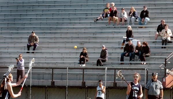 Newburyort: Several were at World War Memorial Stadium to watch Newburyport girls lacrosse host Triton yesterday afternoon in the sun, the stadium blocking some of the windy weather. Bryan Eaton/Staff Photo