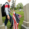 Amesbury: Thatcher Kezer, 9, spies a damaged American flag and replaces it with a new one at Mt. Prospect Cemetery in Amesbury on Tuesday. Students from the Amesbury Elementary School visited cemeteries and memorials to replace the flags of veterans in time for Memorial Day. Bryan Eaton/Staff Photo