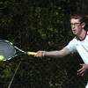 Newburyport: Dan Orencole returns a shot in second singles. Bryan Eaton/Staff Photo