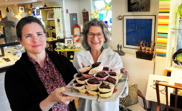 Newburyport: Lucinda Cathcart, left, and owner Christotha Fitzmaurice will be serving chocolate brownies at their shop Chameleon on 22 Middle Street for this weekend's Newburyport Chocolate Tour. Bryan Eaton/Staff Photo