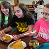 Amesbury: Amesbury Middle School students supported Boston Marathon bombing victims Wednesday by wearing Boston Strong or Boston sports team shirts commemorating the one month anniversary. At lunch, from left, Ariana White, 13, Nicole Palomo and Caitlyn Kane, both 14. Bryan Eaton/Staff Photo