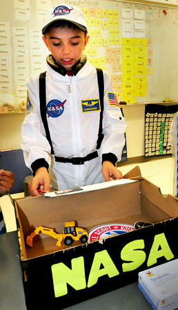 Salisbury: Dominick Robindoux, 8, takes on the persona of Neil Armstrong, the first man on the moon at Salisbury Elementary School. He was part of the Living Museum where second-graders researched people from history and presented their lives to parents who visited for the presentations. Bryan Eaton/Staff Photo