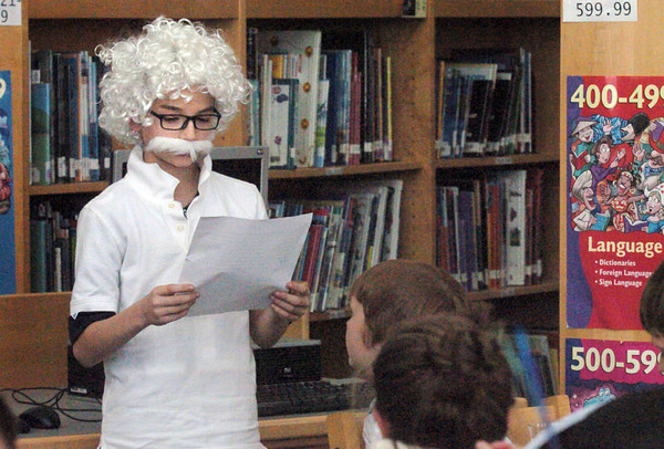 Salisbury: Albert Einstein, also known as Ashton Scibetta, 10, presents his life story at Salisbury Elementary School. The fourth-graders in Kim Peterson and Toni Marie Evans' classes put on an Author's Tea for parents. Bryan Eaton/Staff Photo