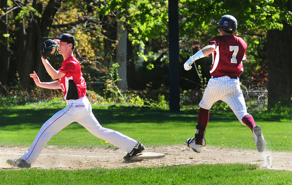 Newburyport: Amesbury first baseman Pat Scanlon has the throw forcing Newburyport's Colton Fontaine out. Bryan Eaton/Staff Photo