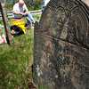Salisbury: Paul Turner applies a special epoxy to broken gravestone at the Salisbury Colonial Burying Ground. The new chair of the Salisbury Historical Commission has been repairing several other stones in disrepair in the town-owned cemetery founded in 1639. Bryan Eaton/Staff Photo