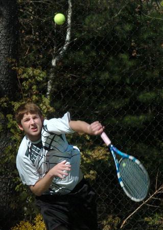 Newburyport: Danny Ryan serves in first doubles against Newburyport. Bryan Eaton/Staff Photo