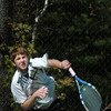 Newburyport: Danny Ryan serves in first doubles against Newburyport. Bryan Eaton/Staff Photo