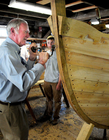Amesbury: Matthew Stackpole, ships historian for the Whale Ship Charles W. Morgan, ceremoniously puts in one of the last screws on last of two sheer planks, which is also the shutter plank and slangly known as the whiskey plank at Lowell's Boat Shop yesterday. The whale boat they are building there is for the previously mentioned whale ship, one of the last in existence which is being restored. Bryan Eaton/Staff Photo