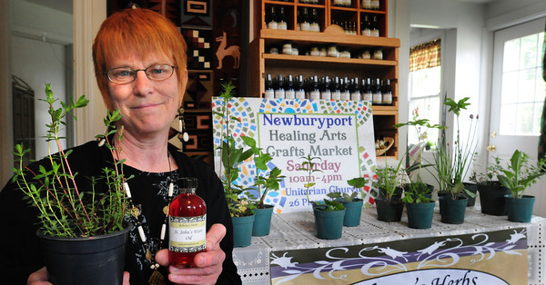 Merrimac: Roberta Horsman is organizer of the Newburyport Healing Arts Crafts Market on Saturday. She grows plants for healing including St. John's Wort which she makes into an oil to ease nerve pain topically. Bryan Eaton/Staff Photo