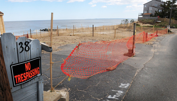 """Newbury: Officials of the state Department of Environmental Protection have filed a """"notice of intervention"""" to temporarily block the building of a house on storm-ravished Fordham Way on Plum Island. Harry Trout's home had been at 36 Fordham Way, the next lot to the right of 38, pictured left. Bryan Eaton/Staff Photo"""