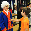"Amesbury: Tyler Bartniski, 7, right, pushes an imaginary button to bring to life ""King George III"" aka Will Legg, 9, at a wax museum at Amesbury Elementary School. The museum was one of several projects on display throughout the school for their ""Celebration of Learning."" Bryan Eaton/Staff Photo"