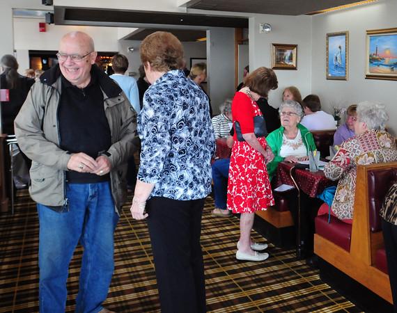 Newburyport: Retired Newburyport Schools teachers mingle before lunch during their bi-annual meeting held at the Starboard Galley. Bryan Eaton/Staff Photo