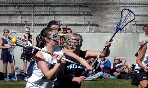 Newburyport: Triton's Lily Dow covers Newburyport player Jillian Ouellette. Bryan Eaton/Staff Photo
