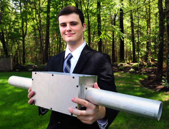Newburyport: Casey Glynn shows the prototype for his emissions converter, an invention designed to reduce an automobile's carbon dioxide emissions. Bryan Eaton/Staff Photo