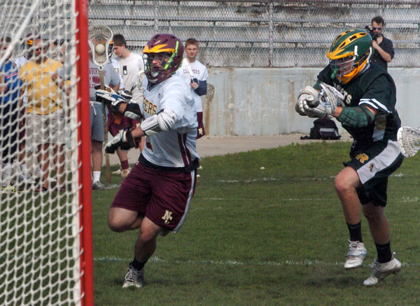 Newburyport: Newburyport's Matthew Kelleher tries for a goal against North Reading. Bryan Eaton/Staff Photo