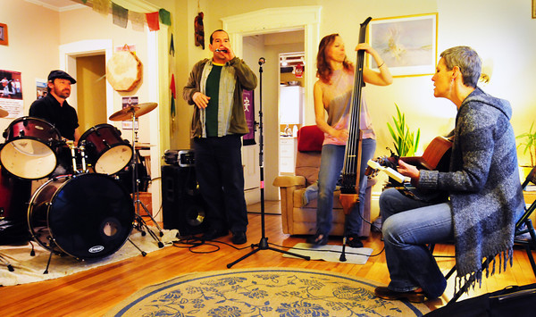 Newburyport: Liz Frame and the Kickers are heading out on a national tour this summer. At rehearsal Wednesday night, from left, Charlie Farr, Jason Novak, Lynne Taylor and Liz Frame. Lead guitarist Mark Toolan is also in the band. Bryan Eaton/Staff Photo