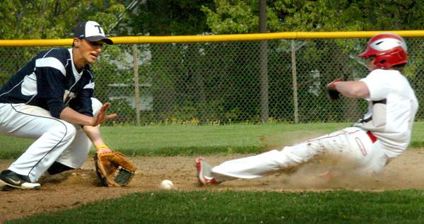 Amesbury: Amesbury's John Pesci was called safe on this slide to Triton second baseman Brad Whitman. Bryan Eaton/Staff Photo