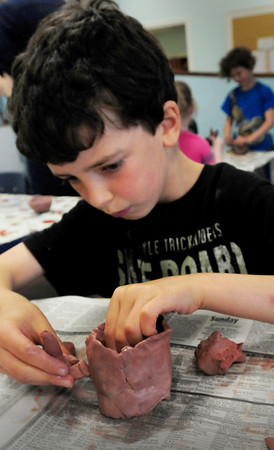 Newburyport: Gabriel Naftoly, 9, of Georgetown puts a handle on a clay cup he's making. He was in art at the Newburyport Montessori School on Thursday. Bryan Eaton/Staff Photo