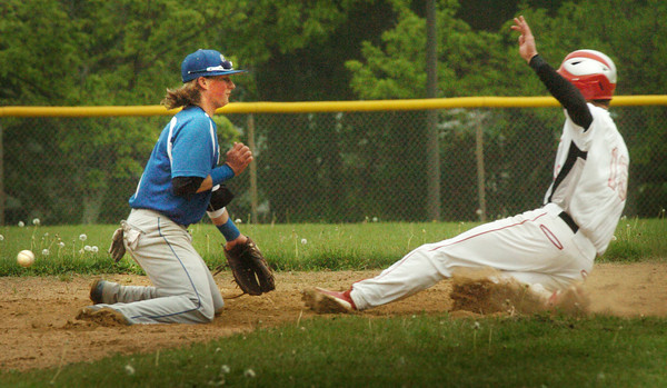 Amesbury: Amesbury's Devlin Gobeil slides into second on a steal as the ball escapes Georgetown second baseman CJ Ingraham. Bryan Eaton/Staff Photo