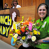 "Merrimac: School ""lunch lady"" Linda Vienneau at the Sweetsir School was given flowers by her daughter, Julie, at a school assembly there on Thursday. She was honored by the School Nutrition Associaton of Massachusetts and was a surprised by the award at the assembly. Bryan Eaton/Staff Photo"