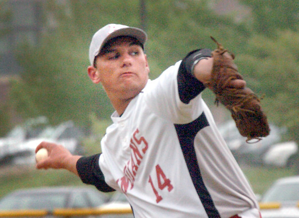 Amesbury: Amesbury pitcher Zach Fitzgerald winds up against Georgetown. Bryan Eaton/Staff Photo