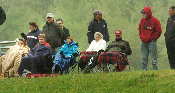 Amesbury: Fans watching the Georgetown at Amesbury High baseball game are bundled up against the windy drizzle that fell yesterday afternoon. Bryan Eaton/Staff Photo