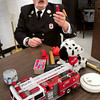 "Merrimac: Merrimac firefighter  Michael McLeieer shows off a lighter, one of several items he shows children when he speaks to break the ice with them in an excercise he calls ""tools versus"" toys, showing items that children know not to or to play with.  He founded the non-profit organization E.S.C.A.P.E. (Education Showing Children and Adults Procedures for Evacuations) which was created to teach children and adults about fire prevention, CPR and first aid."