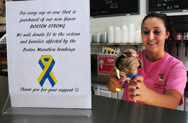 "Newburyport: Kaela McLaughlin scoops ""Boston Strong"" flavored ice cream at Gram's Ice Cream in Newburyport for some students from Immaculate Conception School yesterday. A dollar from each cone will to Boston Marathon victims. The ice cream is a chocolate fudge base with fudge swirl. Bryan Eaton/Staff Photo"