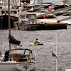 Newburyport: Two kayers about the sailboats and docks fighting an east wind and incoming tide on Newburyport's waterfront on Monday. Bryan Eaton/Staff Photo
