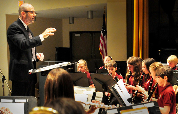 """Newburyport: Nock Middle School music director Thom Stolar conducts the sixth grade band in """"Royal Fireworks"""" at the Newburyport school's Spring Band Concert on Wednesday night. The performance was the last on the school's stage for him as he is retiring after 20 years there. Bryan Eaton/Staff Photo"""