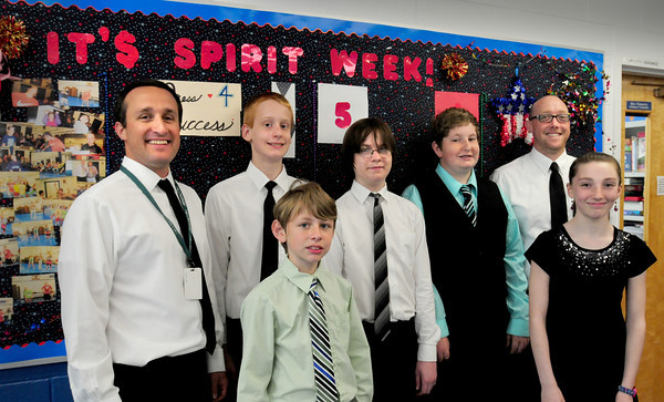 Seabrook: Seabrook Middle School recently held Spirit Week with each day holding a special theme. One day was Dress To Impress, with teachers and students donning fancy attire, from left, Jeff McNally, Scott Rice, 13, Job Helinski, 12, Ryan Marshall, 14, William Dow, 11, Samantha Fitzgerald, 12, and Dan Glover. Bryan Eaton/Staff Photo