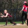BRYAN EATON/ Staff Photo. Newburyport first baseman Carley Siemasko has the throw to force out Amesbury's Rachael Cyr.