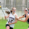 JIM VAIKNORAS/Staff photo Newburyport's Alexandra Peffer makes a move on Hamilton-Wenham's Kayla Fraih during their game Saturday at War Memorial Stadium in Newburyport.