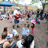 JIM VAIKNORAS/Staff photo  Brian Doser performs in Market Square in Newburyport at the annual Spring Festival Monday.
