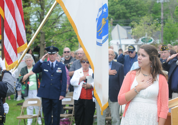 JIM VAIKNORAS/Staff photo Amesbury High School junior Laura Bucher leads the Pledge of Allegiance at the Re-Dedication of the Amesbury Doughboy statue at Amesbury Middle School Sunday.
