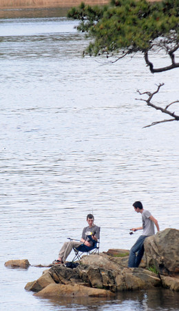 JIM VAIKNORAS/Staff photo  Two fishermen try their luck off Deer Island in Amesbury Sunday afternoon.