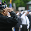 JIM VAIKNORAS/Staff photo Seabrook resident Ivan Eaton salutes during taps at the town Memorial Day ceremony Sunday morning.