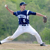 JIM VAIKNORAS/Staff photo  Triton'sNicholas Desrocher pitches against North Reading in Byfield Monday.