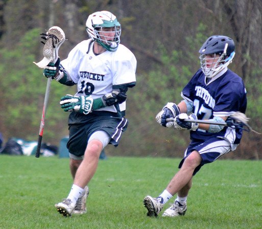 JIM VAIKNORAS/Staff photo  Pentucket's Ryan Beaton is pressured by a host of Triton's Andrew Sheerin during their game at Pipestave Hill in West Newbury.