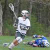JIM VAIKNORAS/Staff photo Pentucket's Sam Colombo makes a move behind the Georgetown net during their game at Pipestave hill in West Newburyport.